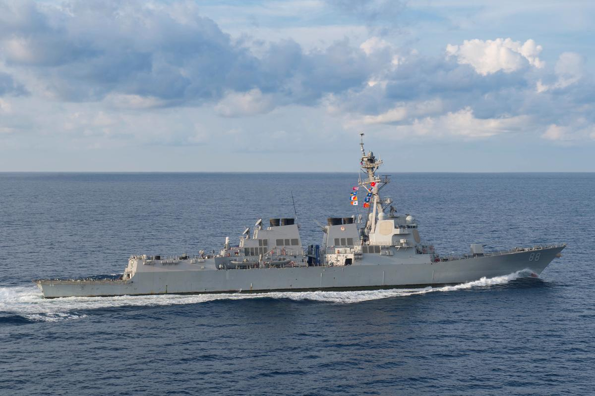 U.S. warship sails in disputed South China Sea amid trade tensions - Reuters image