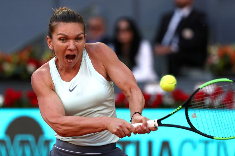 Holder Halep shrugs off expectations ahead of French...