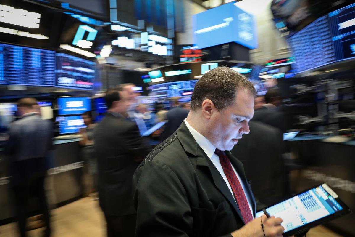 Wall St. slips as trade tensions mount; Fed minutes awaited