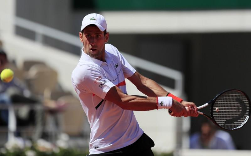 Djokovic saunters into French Open fourth round