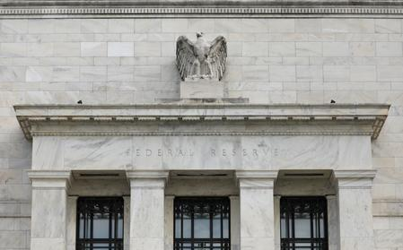 Fed says contacts worry about trade war; economy growing modestly