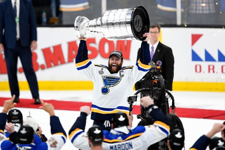 695d3886f30 St. Louis Blues defenseman Alex Pietrangelo (27) holds the Stanley Cup in  front