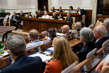 UPDATE 3-Pope backs carbon pricing to stem global warming and appeals to deniers