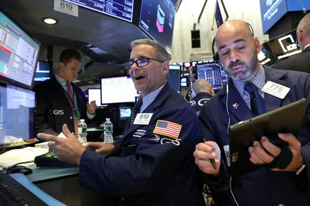 Fed rate-cut signal sends stocks surging, wounds yields, dollar
