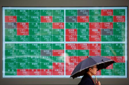 Asian stocks fail to catch Wall Street's Fed rally as trade angst persists