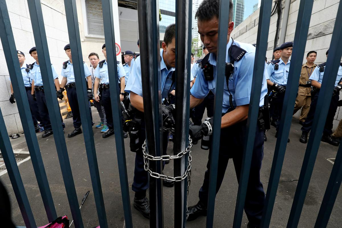 Fate of 24 arrested Hong Kong protesters hangs in balance as anger turns on police