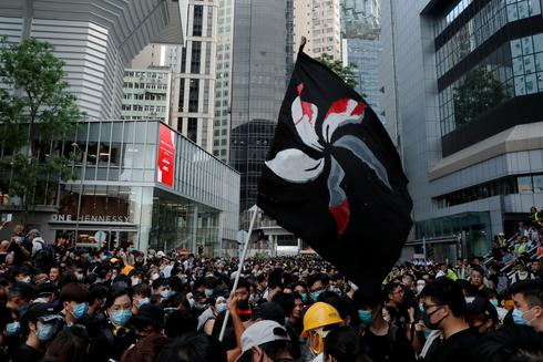 Black-clad, anti-extradition protesters flood streets of Hong Kong