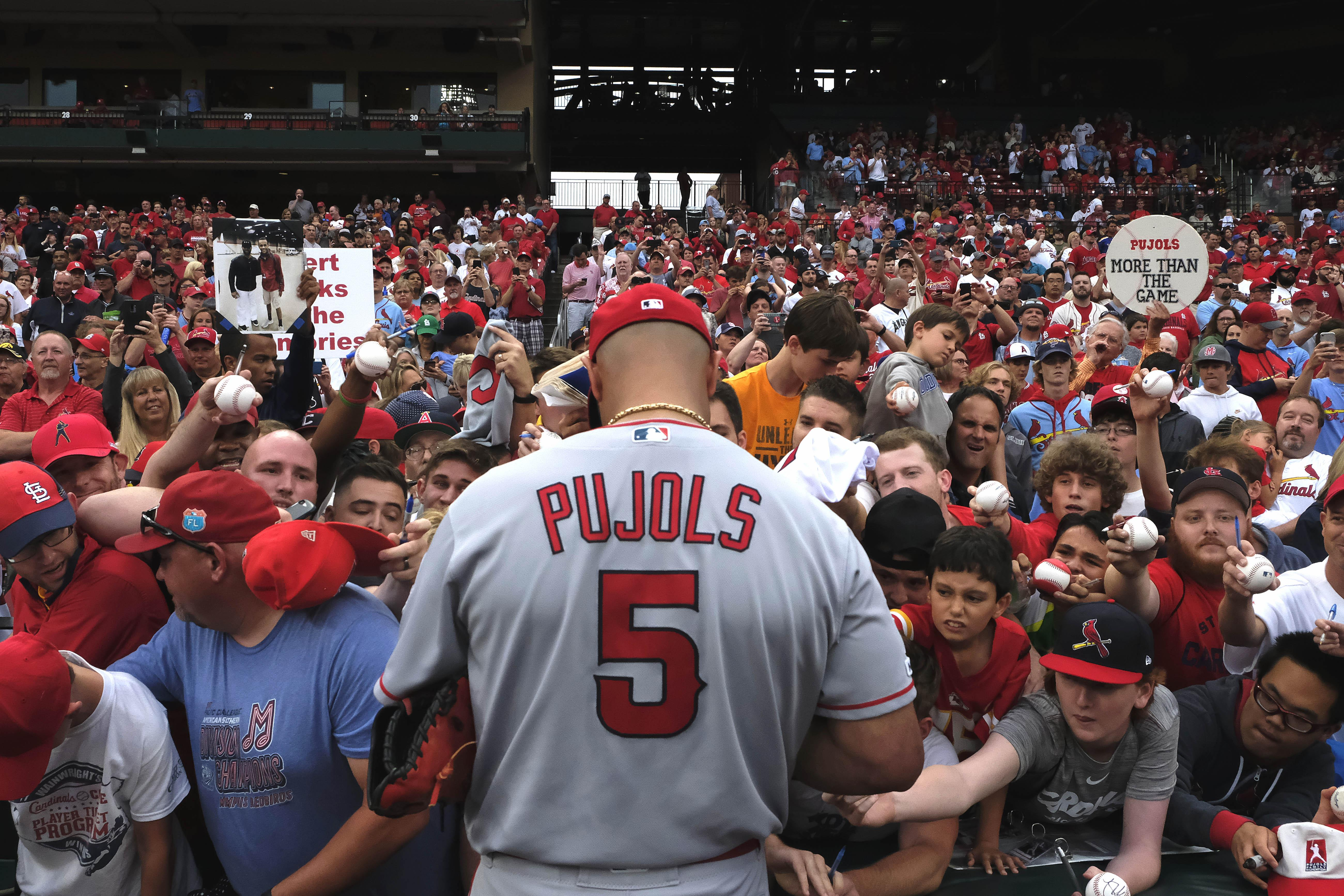 Cards dump Angels in Pujols' return to St. Louis