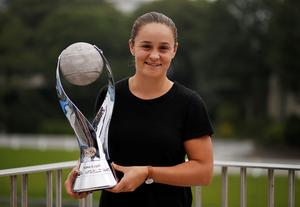 New world number one Barty out of Eastbourne with arm injury