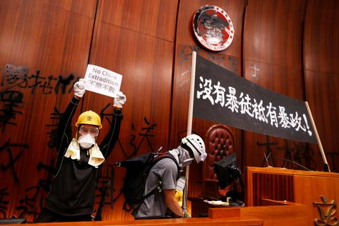Hong Kong protesters storm legislature on handover anniversary