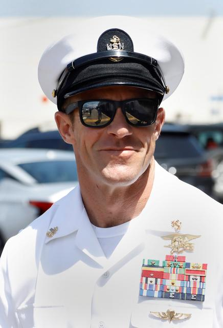 U S  Navy SEAL acquitted of murder in war crimes trial - Reuters