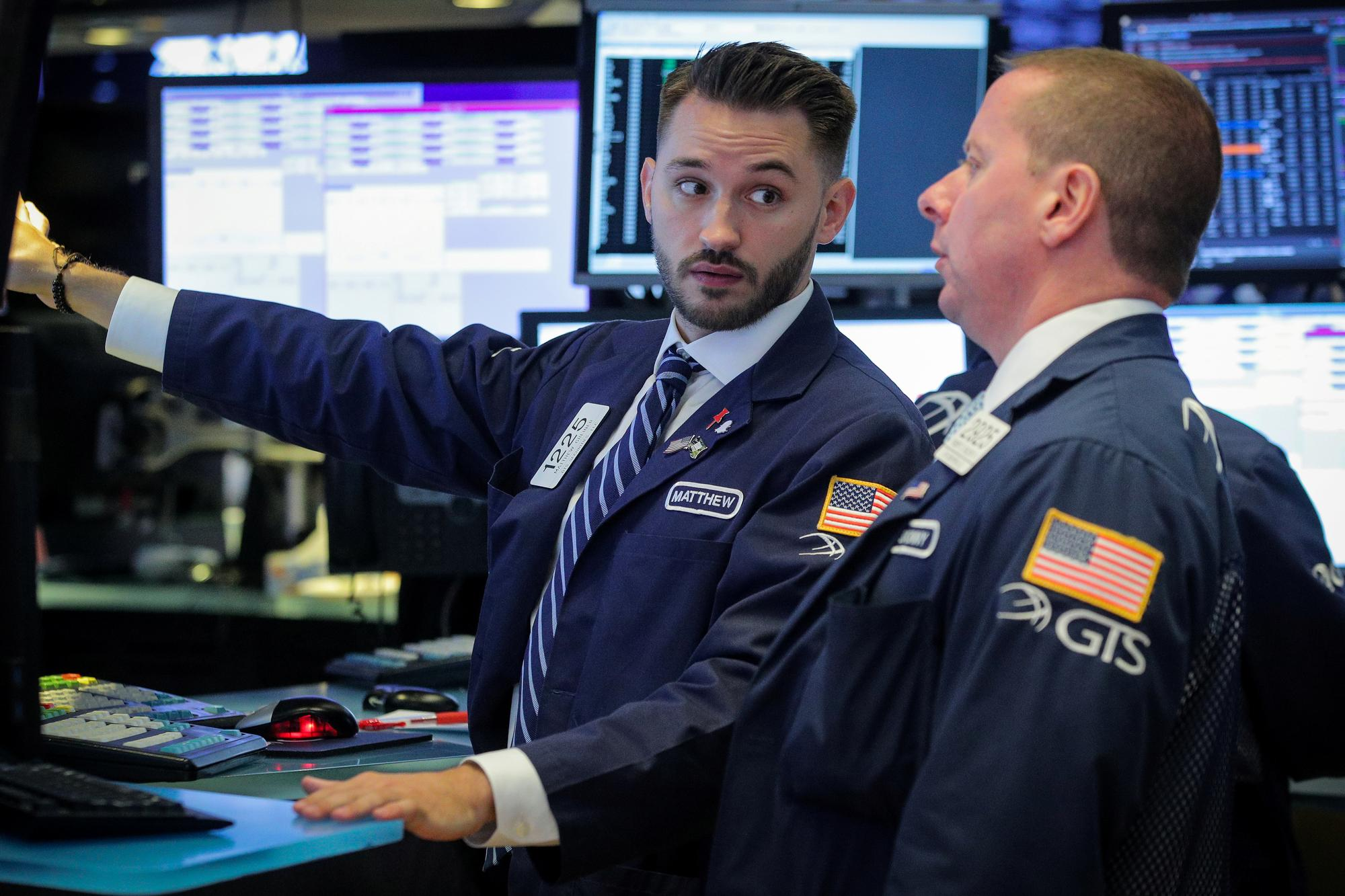 Wall Street opens lower after strong jobs data