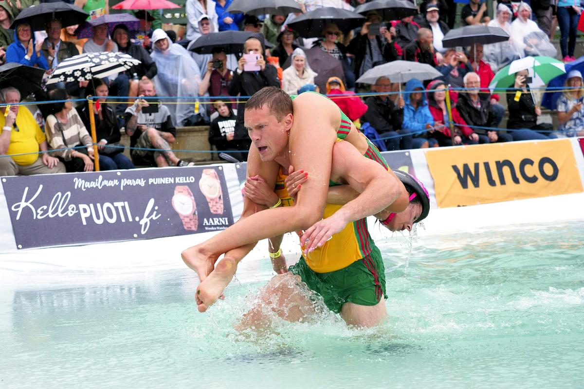 Lithuanian couple defends world wife-carrying championship title
