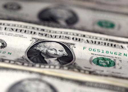 CORRECTED-FOREX-Dollar hovers at three-week high as bets for deep U.S. rate cut fade