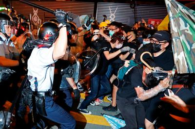 Clashes break out as Hong Kong protesters march through Kowloon