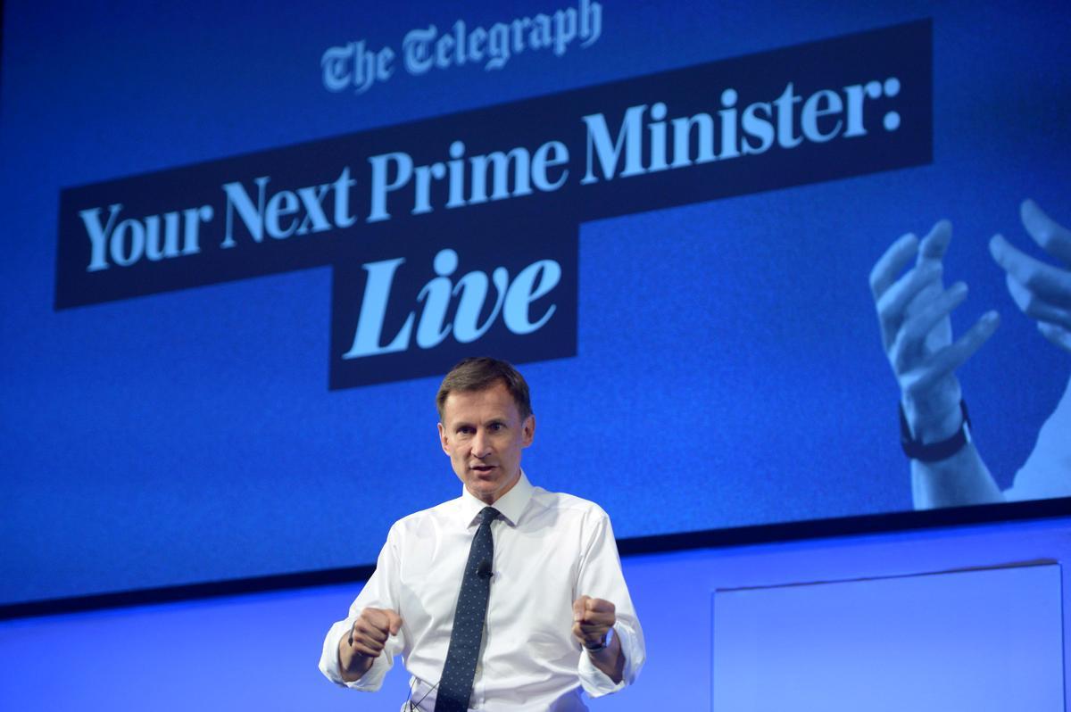 UK PM contender Hunt tells Trump he is wrong in envoy spat