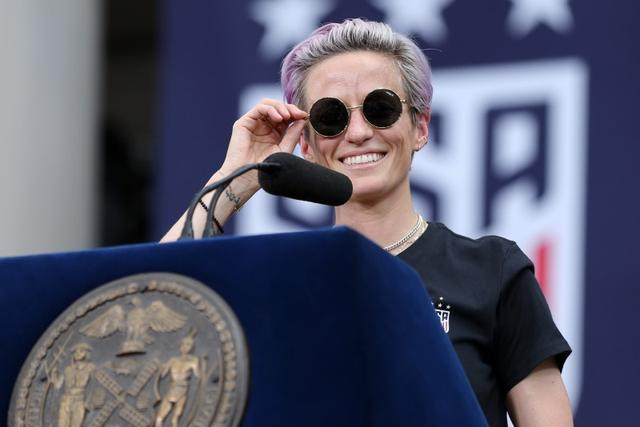 Jul 10, 2019; New York, NY, USA; United States women's national team forward Megan Rapinoe (15) speaks at New York City Hall after the ticker-tape parade for the United States women's national soccer team down the canyon of heroes in New York City. Mandatory Credit: Brad Penner-USA TODAY Sports