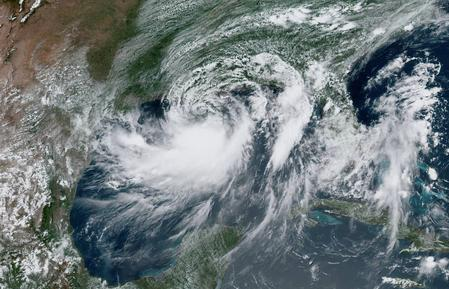 Barry makes landfall in Louisiana, weakens to tropical storm