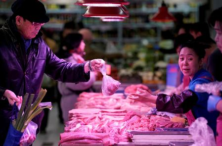 China's first-half pork output falls amid disease outbreak