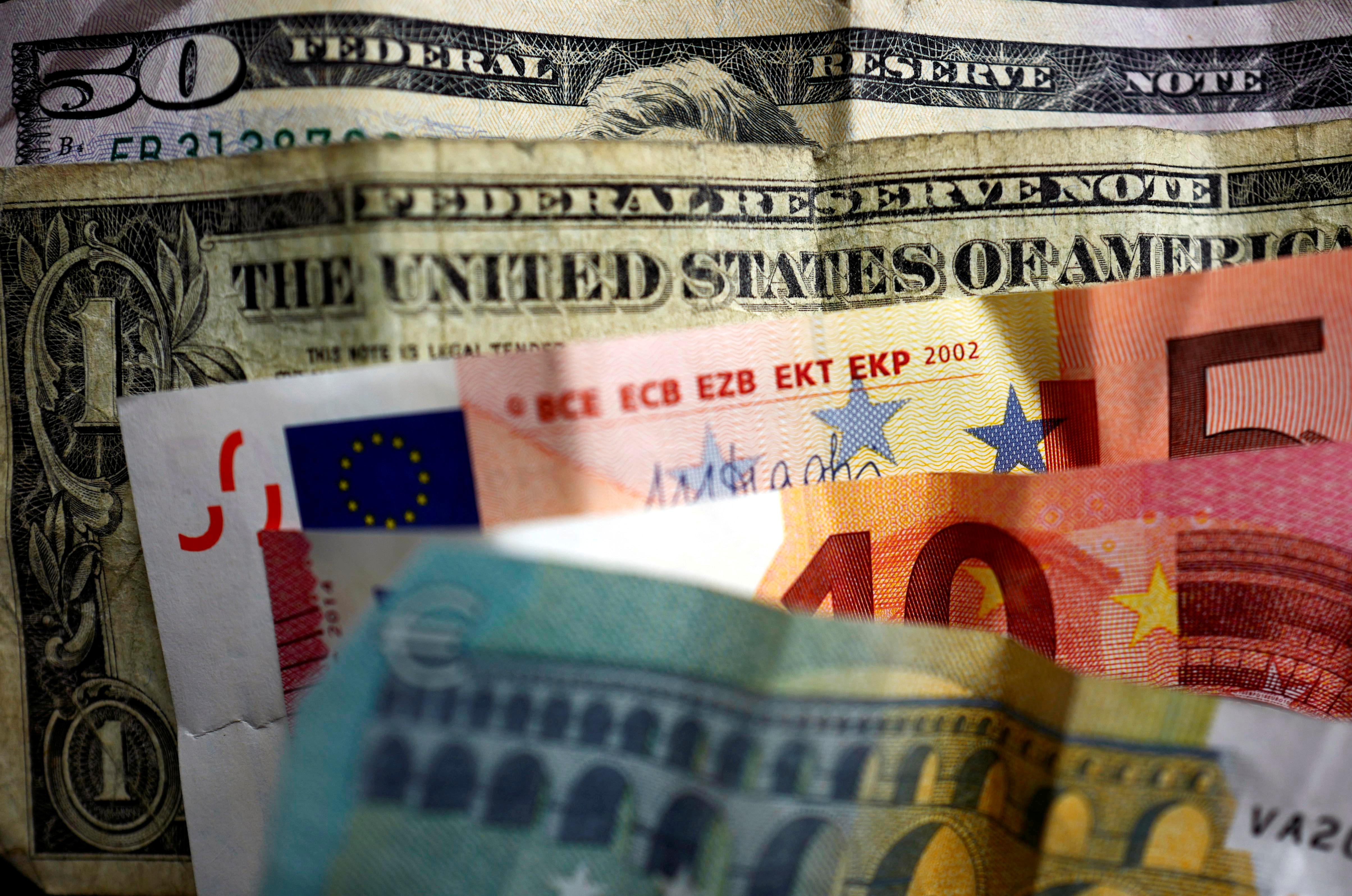 Dollar drifts higher in thin summer trading; upside capped
