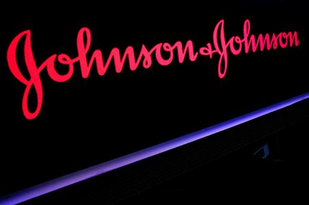 UPDATE 2-Johnson & Johnson beats profit estimates on pharma strength, raises sales outlook