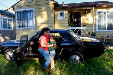 Ashley Avila, 11, with her nephew Alexander Avila, 3, outside of their home...