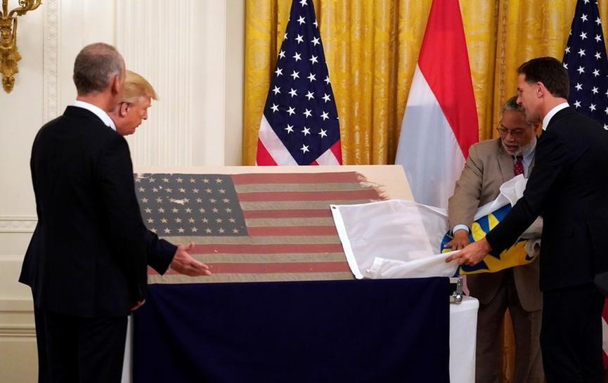 Bullet-riddled U.S. flag that survived D-Day comes home 75 years later