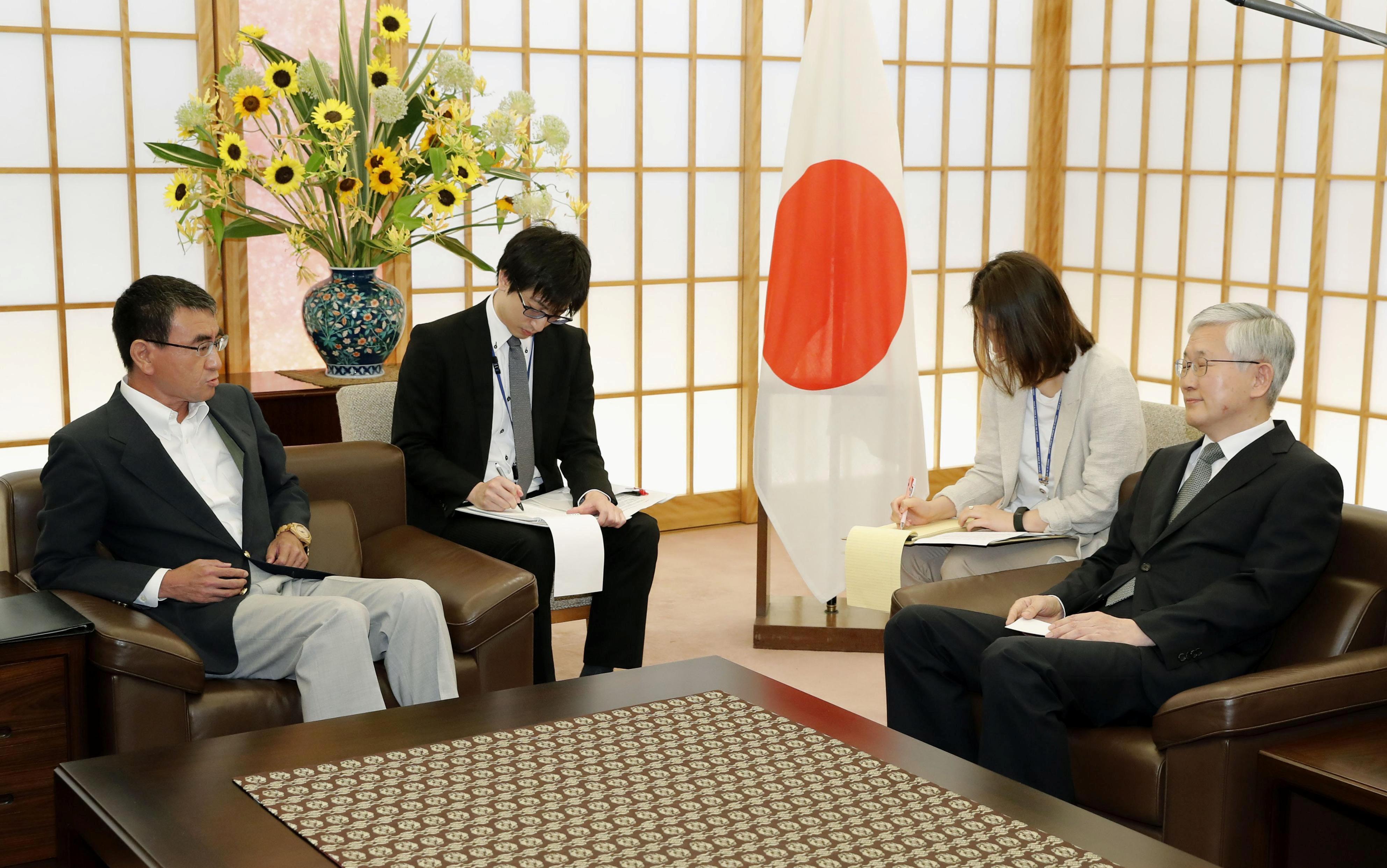 Japanese minister admonishes South Korea's envoy as row escalates
