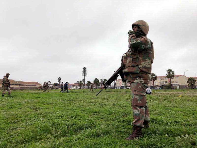 Far from Cape Town tourist sites, a gangland battle rages