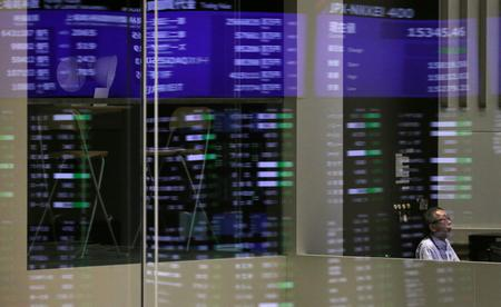 Asia stocks fall on likely smaller Fed rate cut, crude climbs