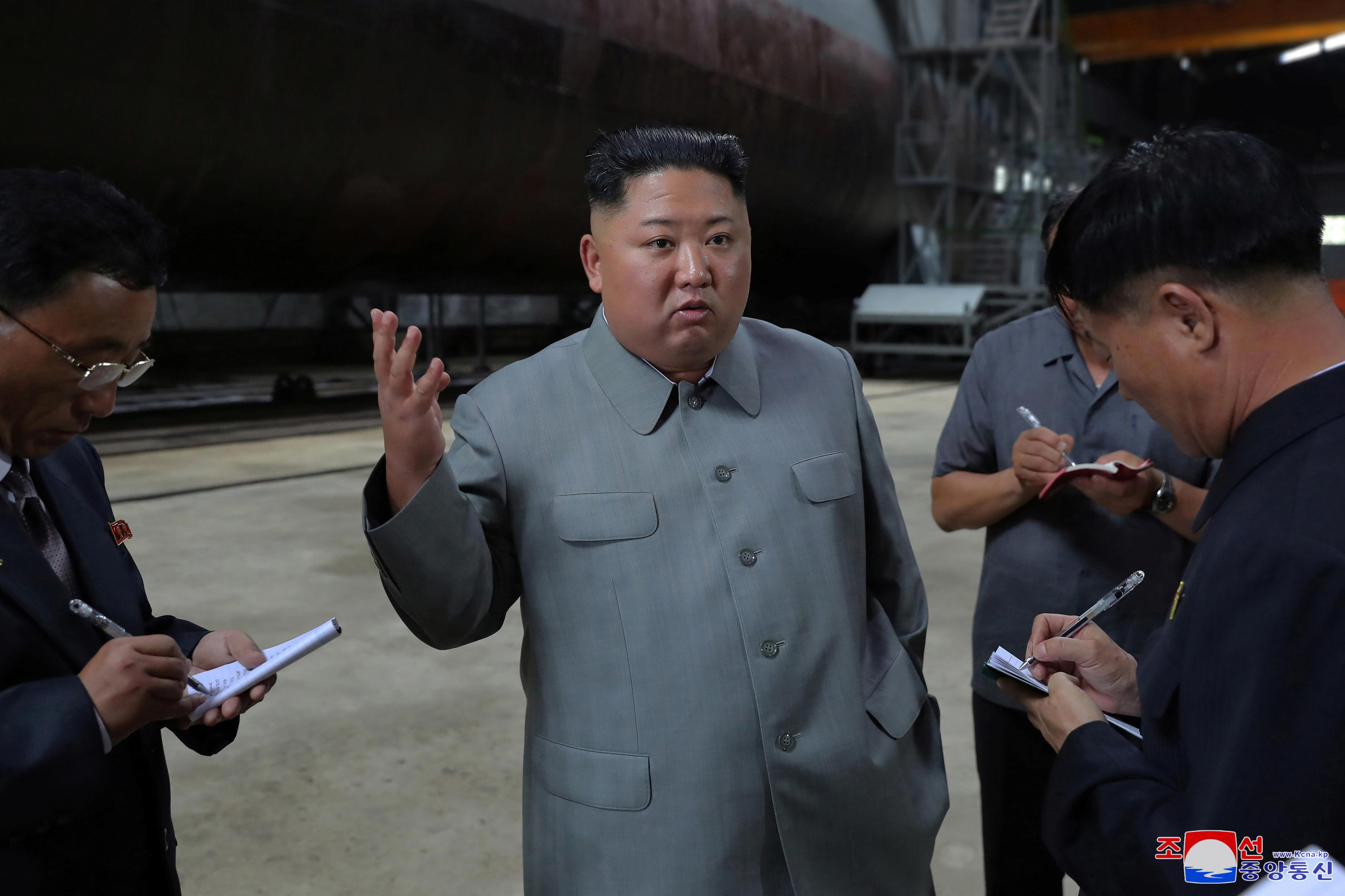 North Korea's Kim inspects new submarine, signals possible ballistic missile development