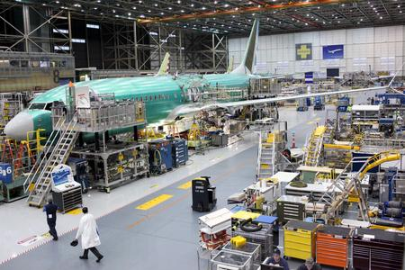 Boeing posts biggest loss on 737 MAX, may have to halt production of jet