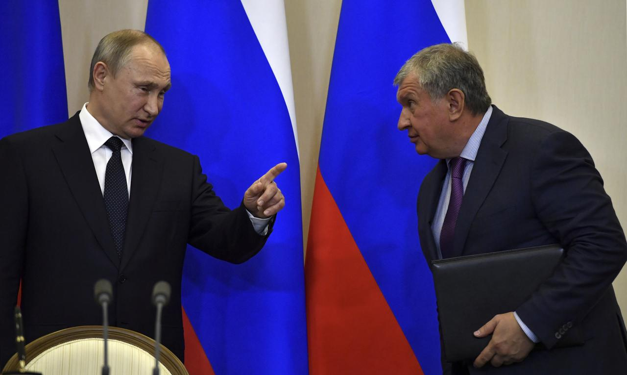 Image result for Putin allies' oil feud spills into public view