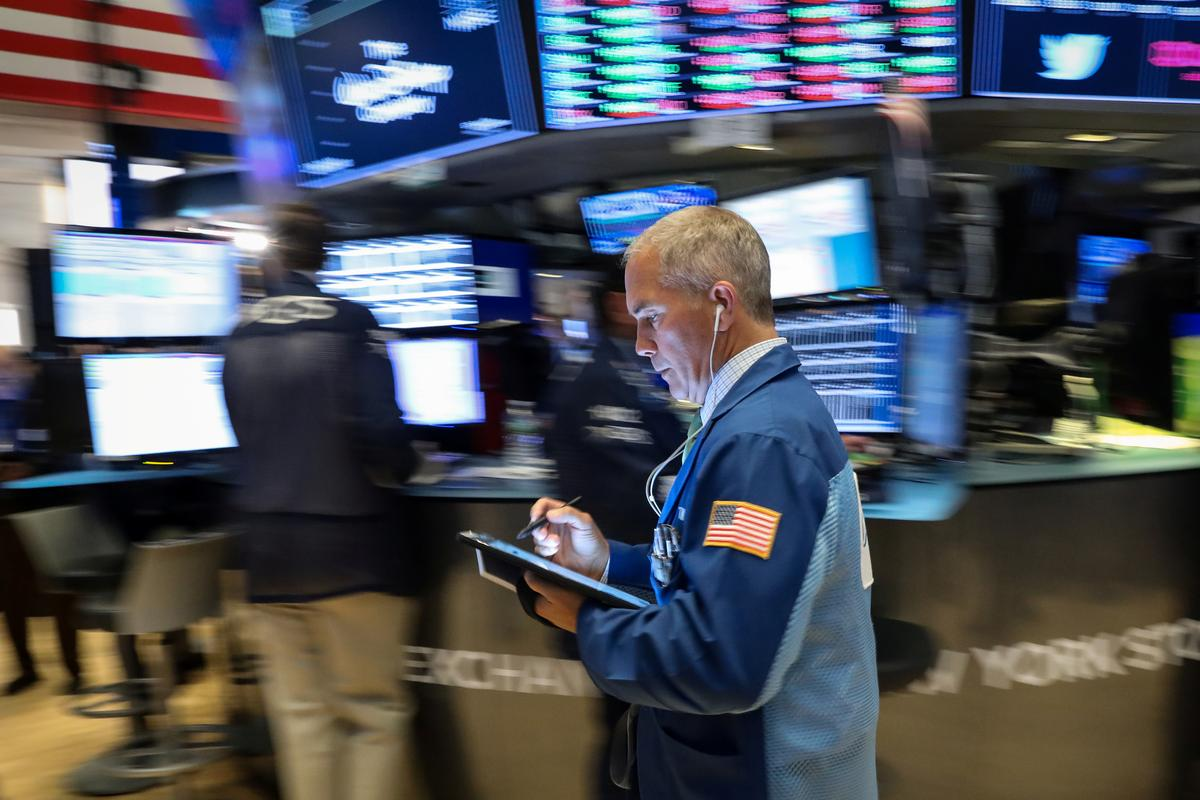 Wall St. declines on weak earnings reports; ECB disappoints