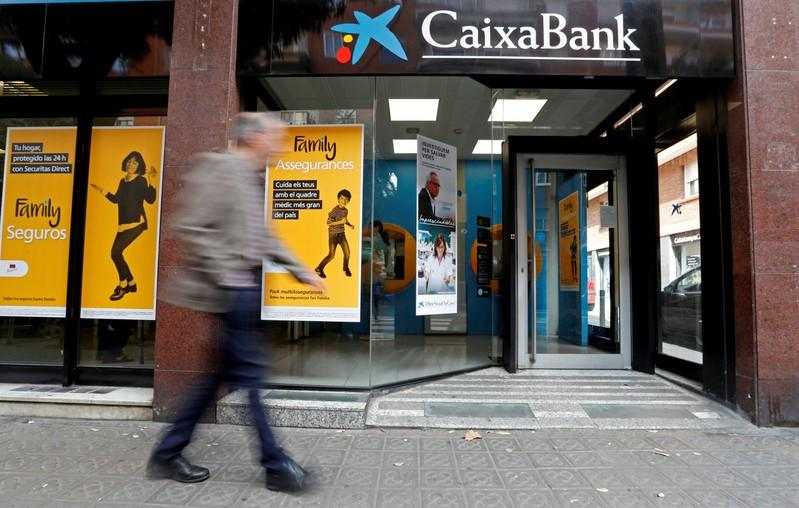Spain's Caixabank and Sabadell cut income forecasts, shares