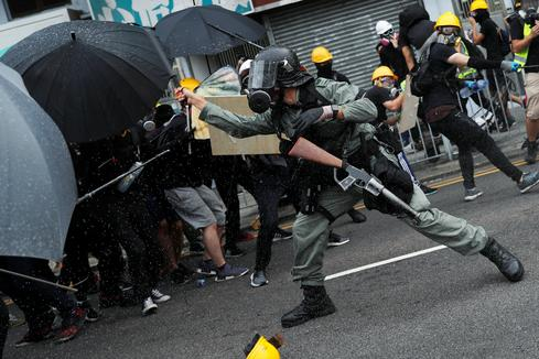 Protesters clash with police during anti-triad march in Hong Kong