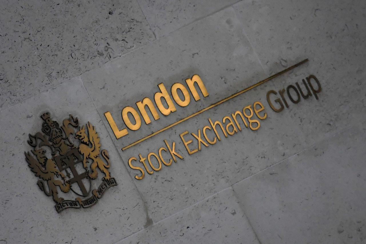 a6369c3c FTSE 100 shoots to 11-month high on pound dip, M&A - Reuters