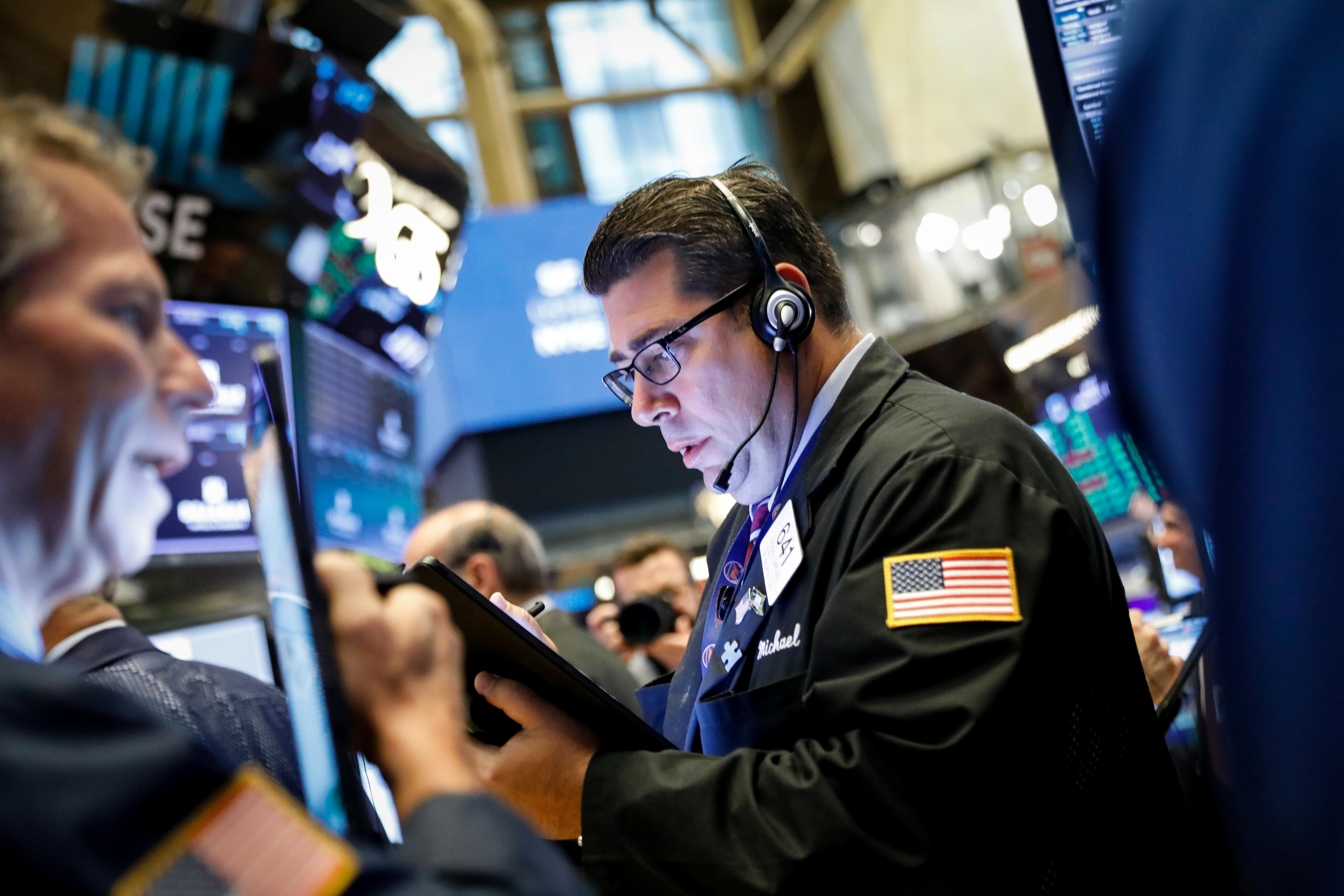 Stock markets mixed, U.S. climbs as currency war fears ease