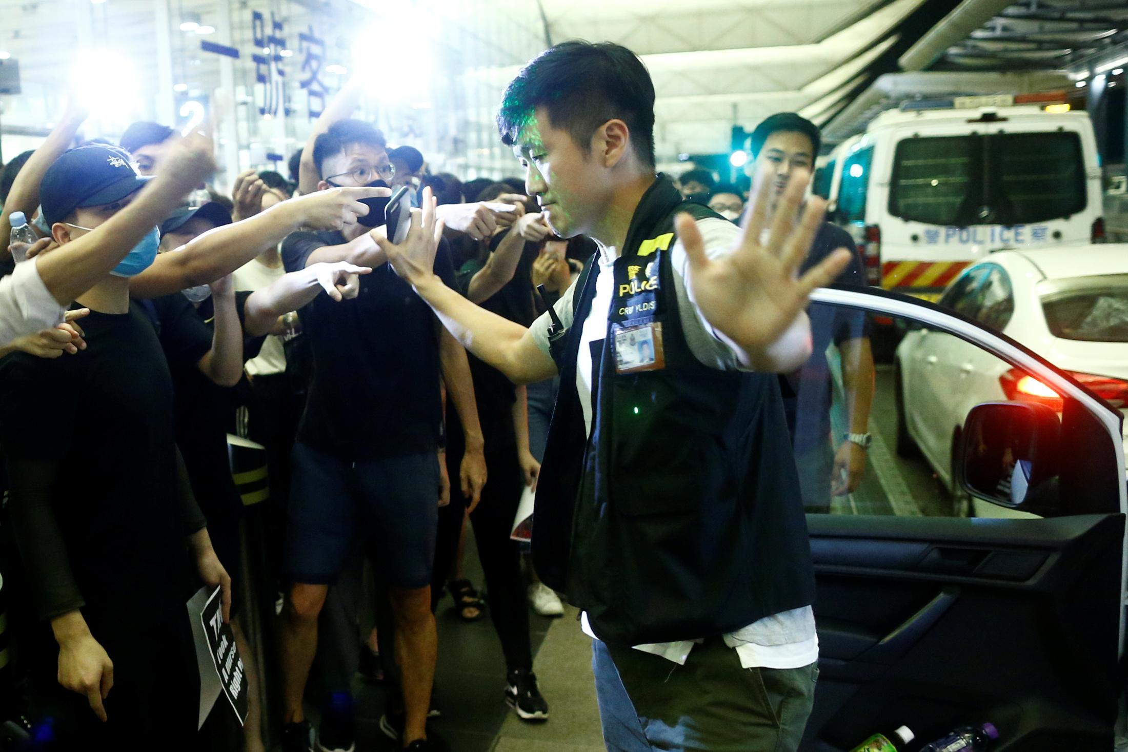 Clashes at Hong Kong airport after flights halted