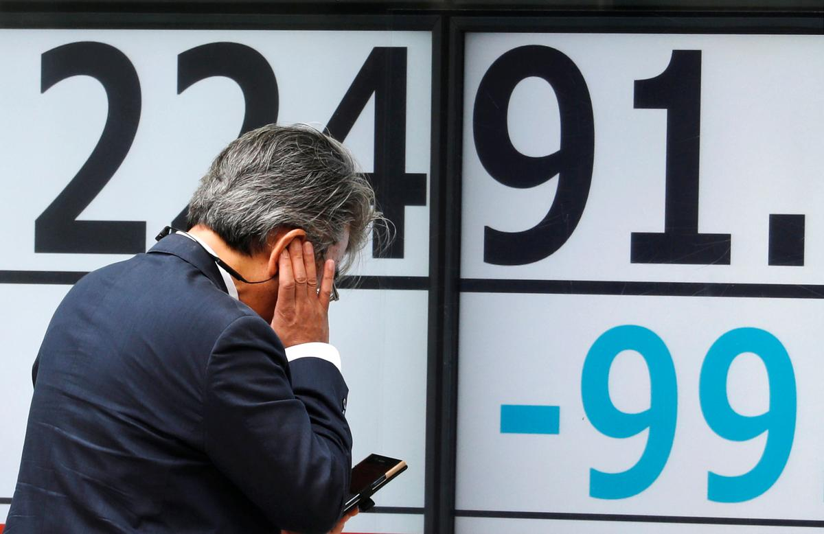 Global stocks routed, oil sinks as bond markets flash recession warning