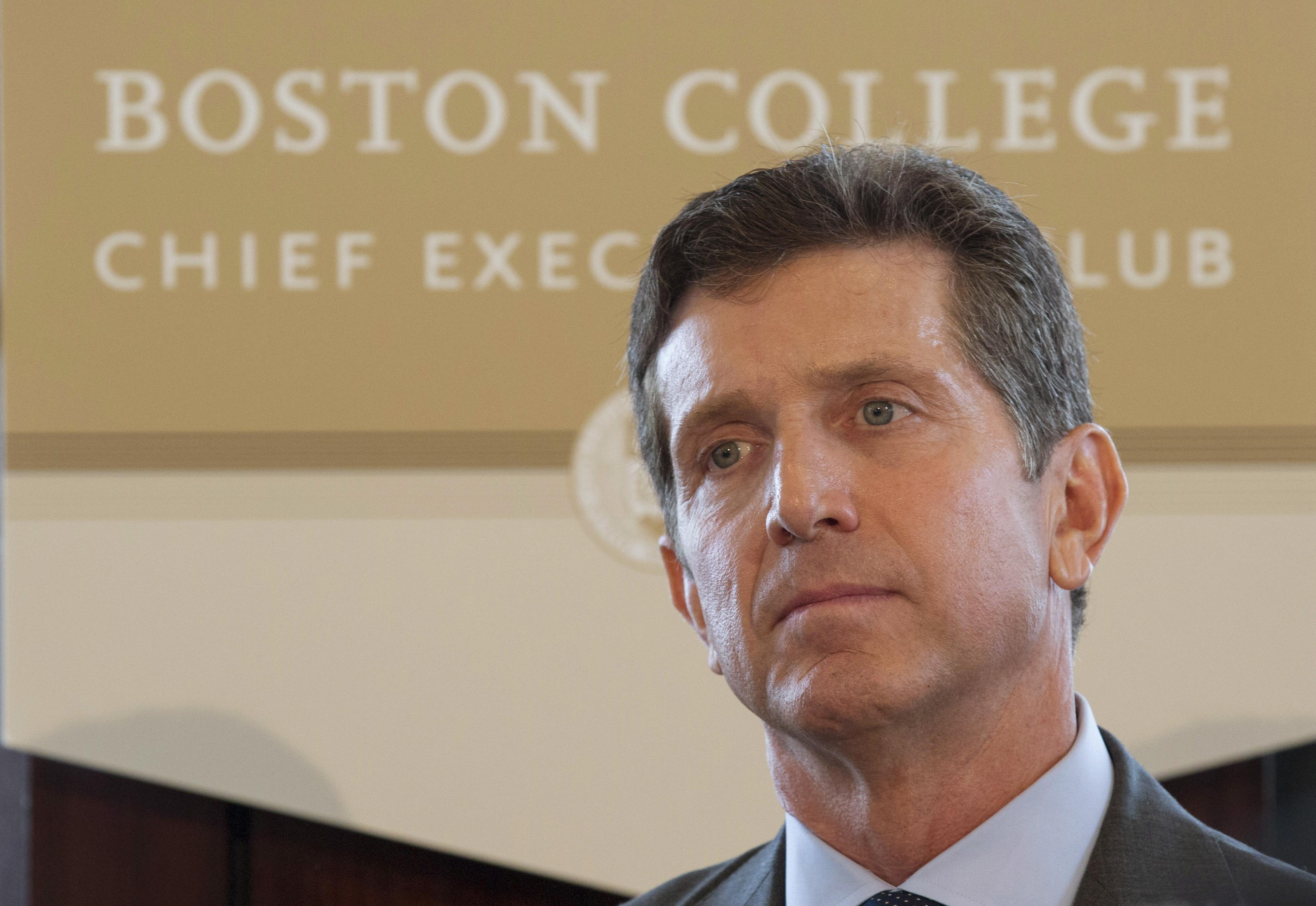 Alex Gorsky, CEO of Johnson & Johnson, listens as he is introduced to speak at the Boston College Chief Executives Club luncheon in Boston, Massachusetts September 11, 2015.   Brian Snyder