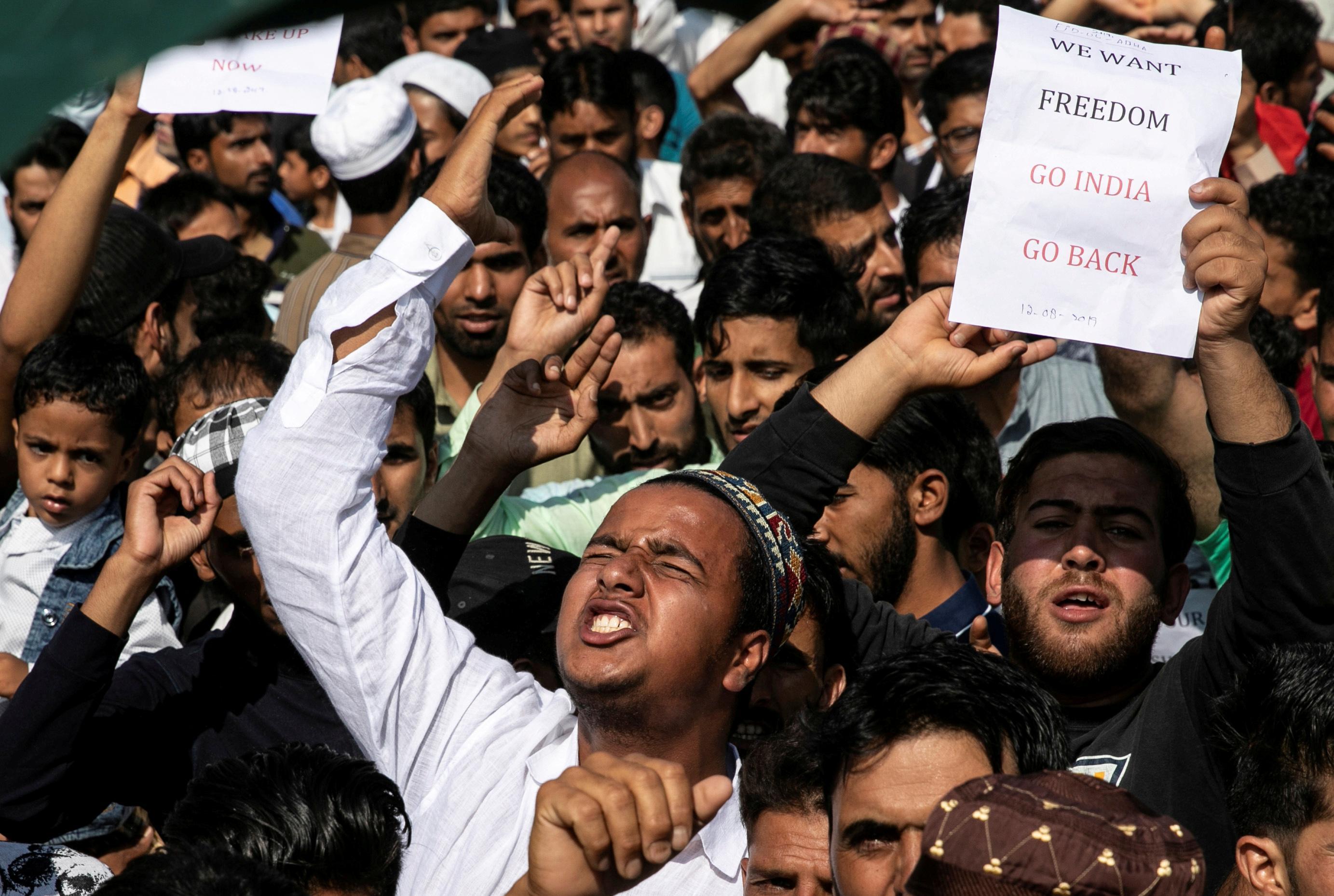 Besieged Kashmiri neighborhood in test of wills with India's Modi
