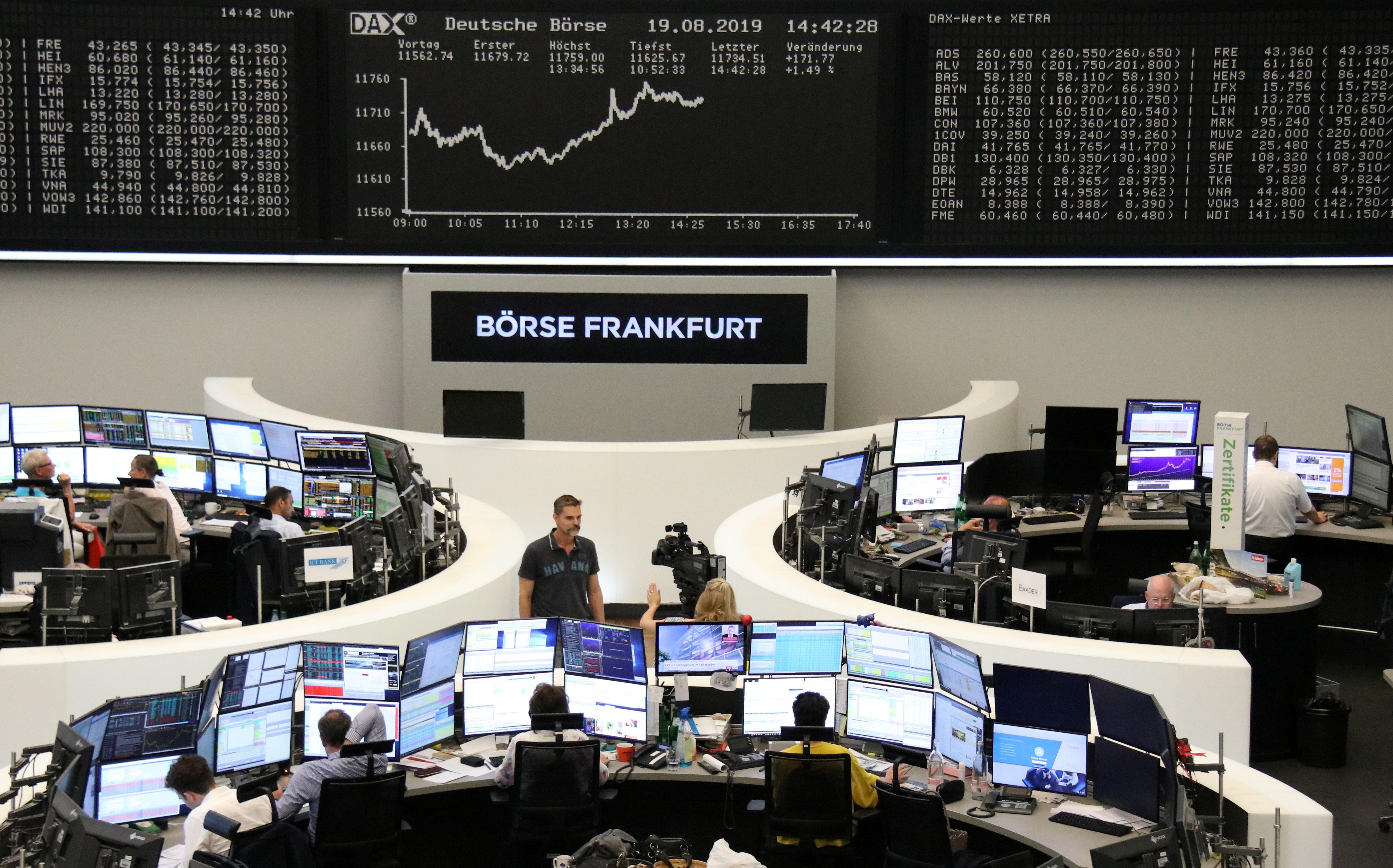 Global stocks inch higher as stimulus hopes spur tentative rebound