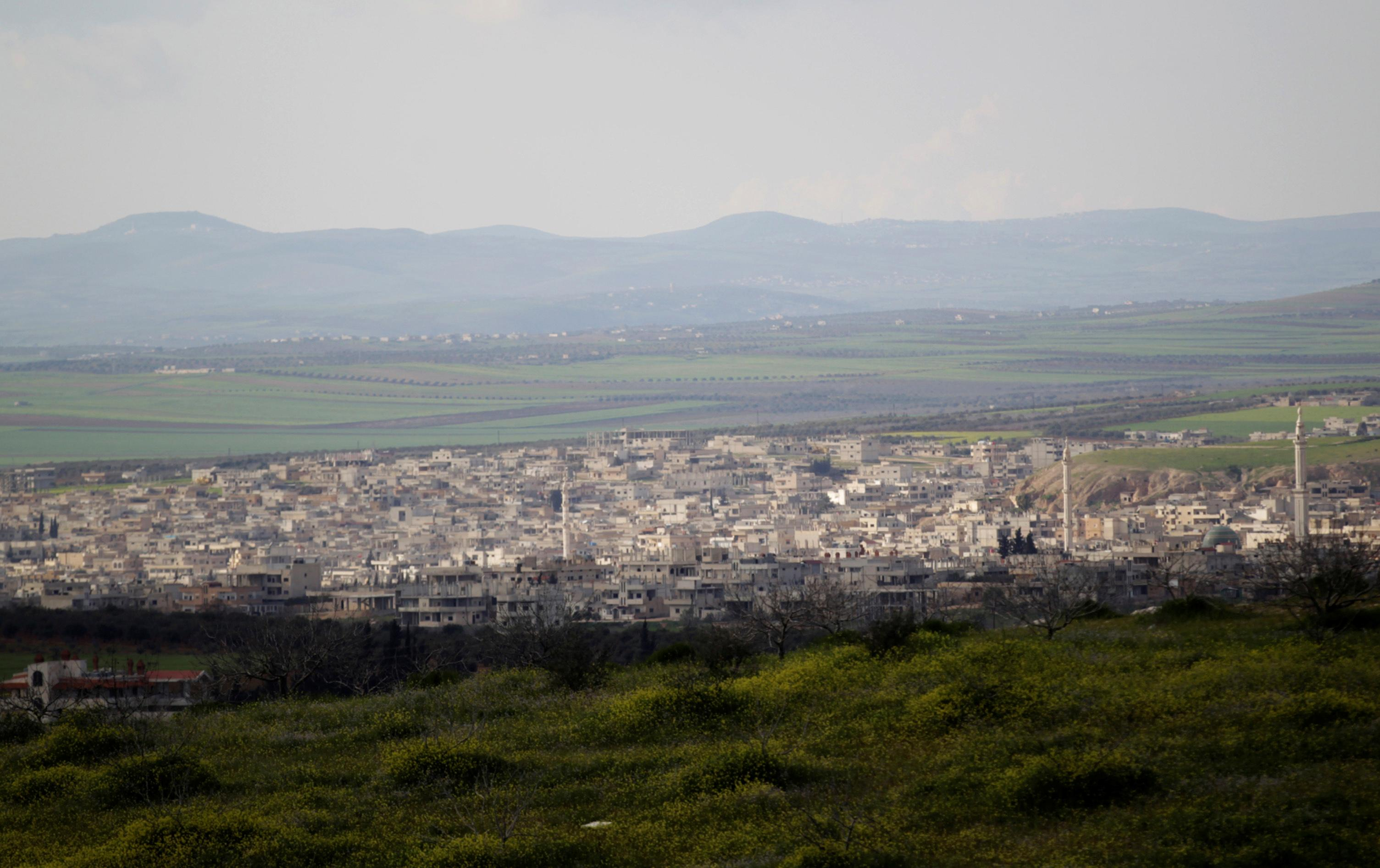 Syrian army poised to take key town after rebel withdrawals