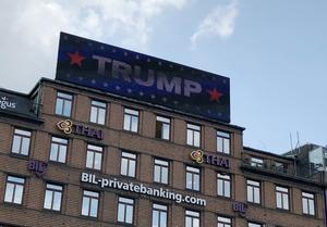 A digital billboard displays a sign reading