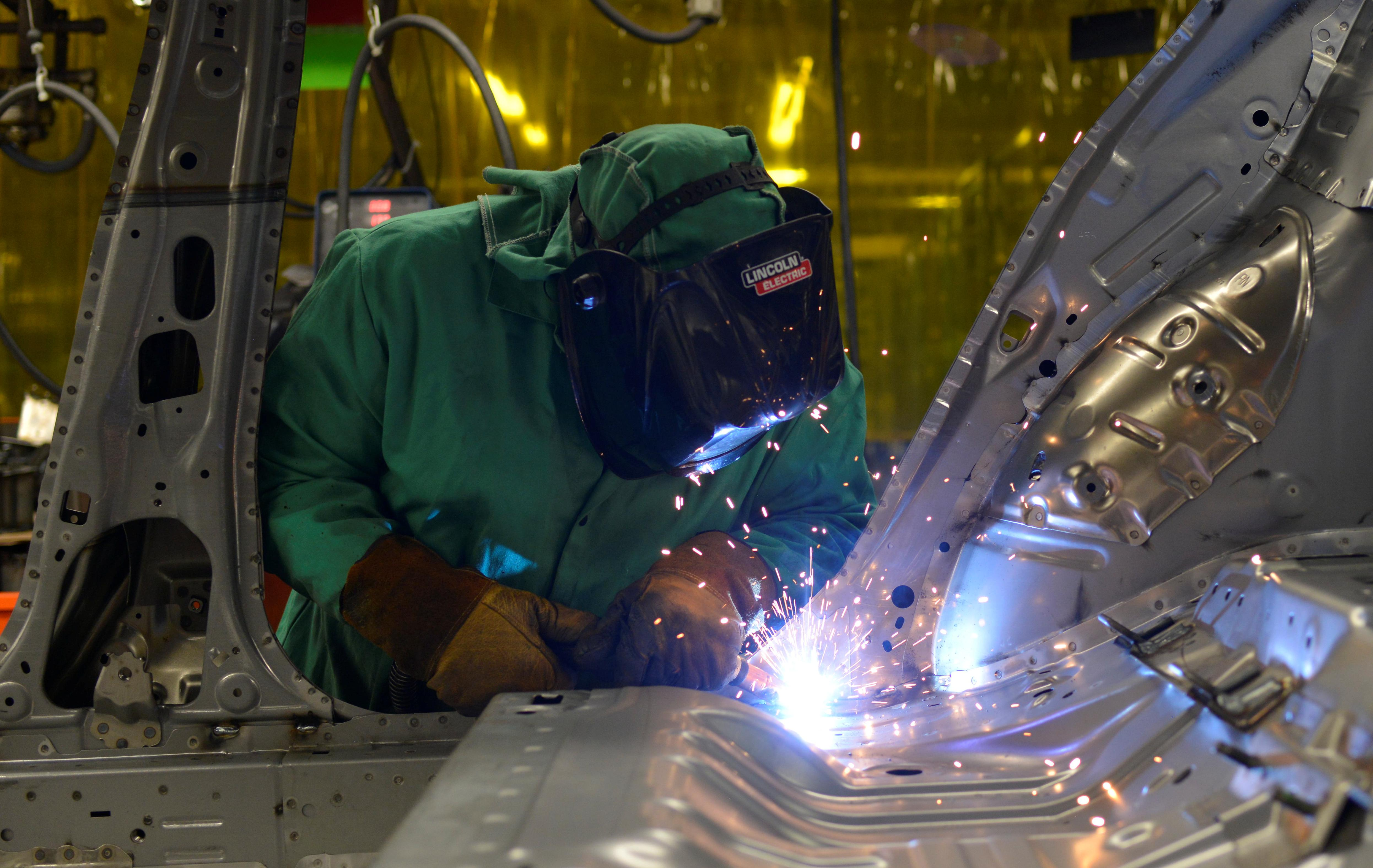U.S. factories show signs of trouble; labor market still firm