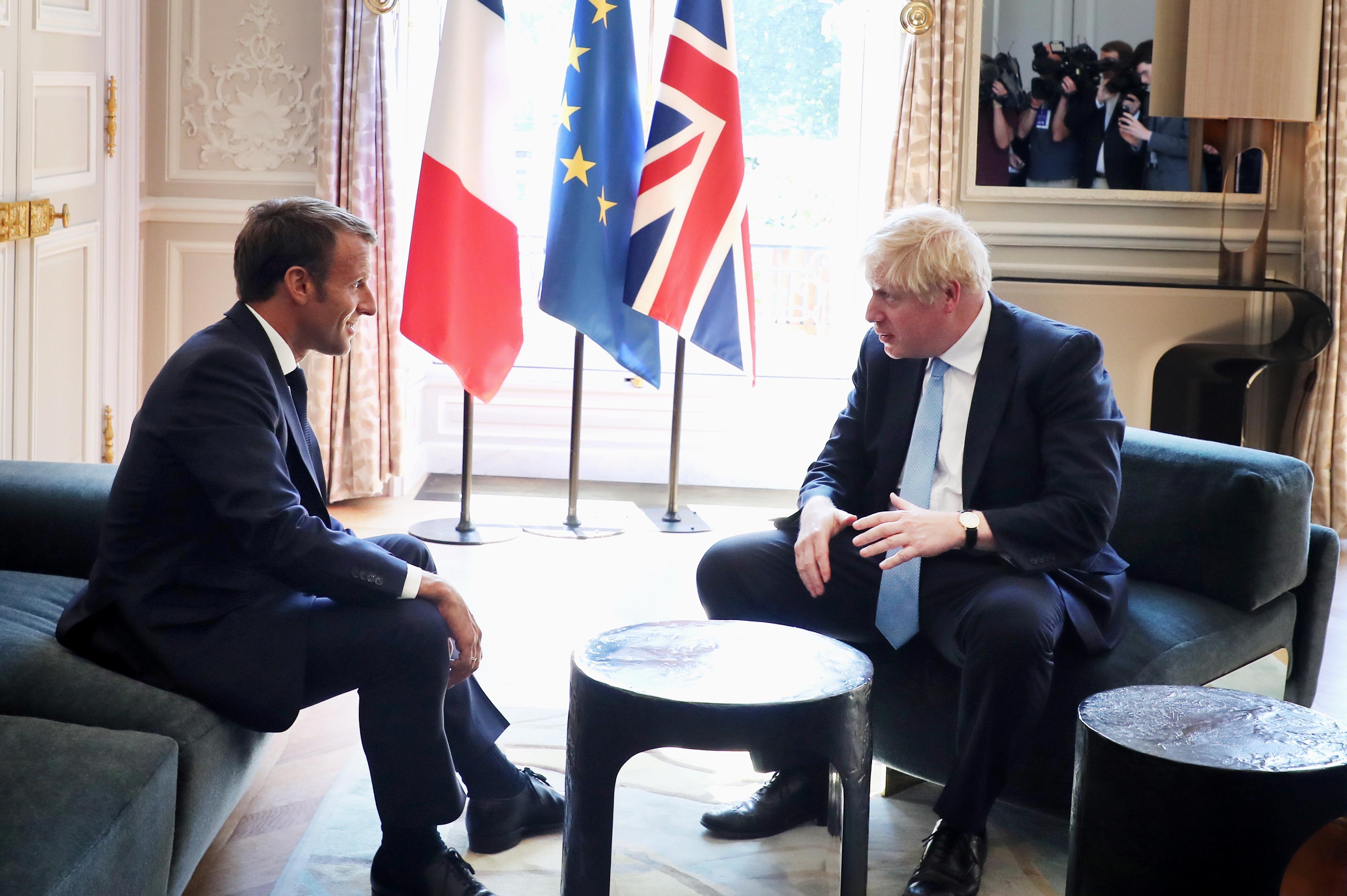 Britain-EU talks must respect single market integrity, Irish stability - Macron