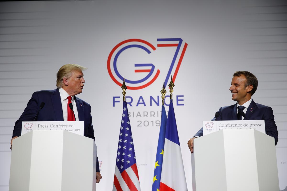 Macron defuses French digital tax row, Trump coy on wine threat