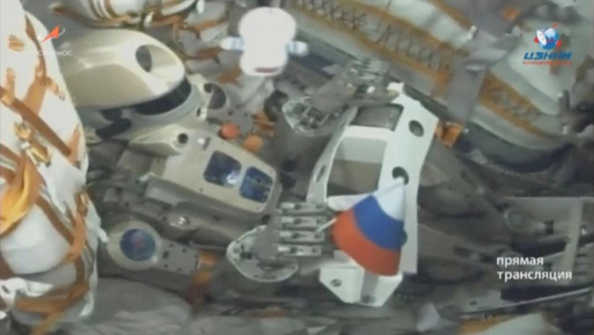 Russian spacecraft carrying robot docks with space station: TASS