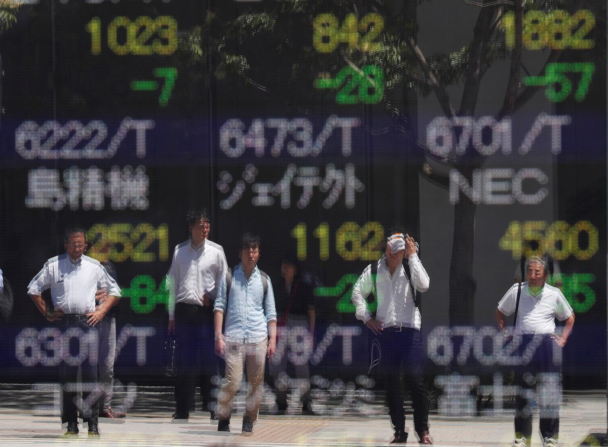 Bond yields near record lows, shares struggle on darkening global outlook